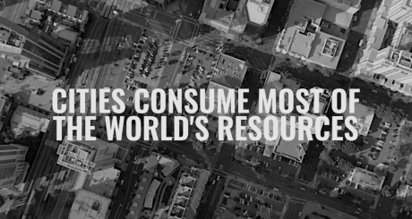 A screenshot from the fab city website. It shows a big city from above. Above the image is a slogan: cities consume most of the worlds resources.