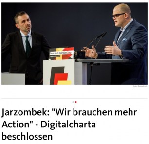 "The image shows Thomas Jarzombe on the left, and Prof Dr. Jörg-Müller-Lietzkow on the right, a picture above a headline.saying: 'Wir brauchen mehr action"" - DIgitalcharta beschlossen."
